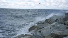 Wave splash at the pier on a stormy day Stock Footage