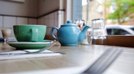 Woman picking up tea cup Stock Footage