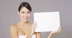 Young woman displaying a blank white sign Stock Footage
