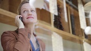 Blond woman talking on phone Stock Footage