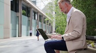 Man working on laptop outdoors Stock Footage