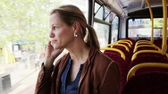 Woman talking on phone in bus Stock Footage