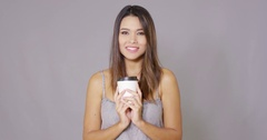 Young woman offering a cup of takeaway coffee Stock Footage