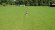 Boy on football field Stock Footage
