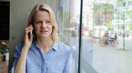 Woman talking on smartphone Stock Footage