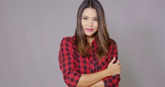 Single woman wearing checkered red and black shirt Stock Footage