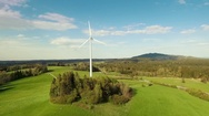 Rural landscape with wind turbine Stock Footage