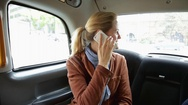 Woman in car with phone Stock Footage