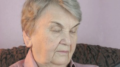 Elderly woman talks on smartphone with smile Stock Footage