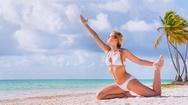 Woman practicing yoga on beach Stock Footage