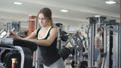 Smart girl working out with simulator in the gym in 4K Stock Footage