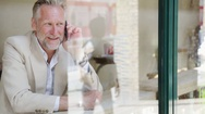 Man talking on phone in cafe laughing Stock Footage