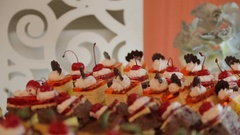 Buffet table, cake with cherries Stock Footage