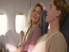 Attractive young couple traveling in main cabin of commercial airliner 4K Stock Footage