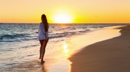 Young woman running on beach Stock Footage