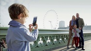 Boy photographing family Stock Footage