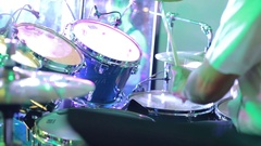 Concert rock band performing on stage with singer performer, guitar, drummer. Stock Footage