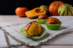 Spiced butternut squash muffins in the green wrappers Stock Photos