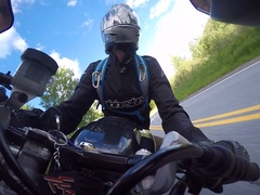 CRASH motorcycle dash mount captures rider slamming to ground in corner Stock Footage