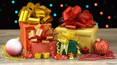 Beautiful Christmas gift boxes and decorations and colorful flashing garland Stock Footage