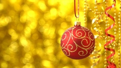 Christmas red with golden pattern ball spinning. New Year decoration. Blurred Stock Footage