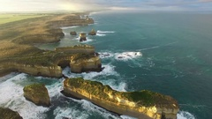 Static aerial shot of Island Archway and rugged coastline at sunrise Stock Footage