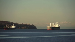 Close-up of Container Ships Anchored in English Bay at Dawn Stock Footage