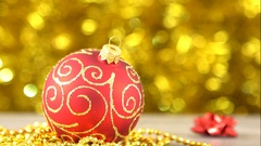 Christmas red with golden pattern ball. Blurred Golden Bokeh glimmering. New Stock Footage