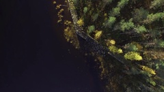 Vertical view of a historic stone wall barrier by a lake, aerial shot Stock Footage