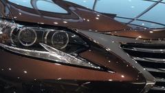 Car headlights in modern car showroom Stock Footage