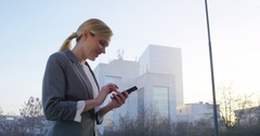 4K Cinemagraph: Business Woman Typing On Mobile Stock Footage