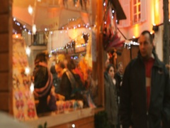 Defocused blur Christmas market with people shopping gifts and sweet foods Stock Footage