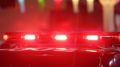 Flashing sirens of police car in downtown Stock Footage