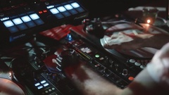 DJ hands on equipment making scratch in nightclub. Disk Jockey on open air Stock Footage