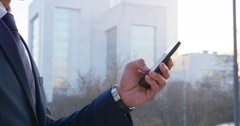 4K Cinemagraph: Businessman Dialing Phone Number On Phone Stock Footage