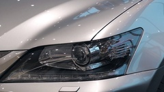 Car headlights in modern car showroom Stock Footage