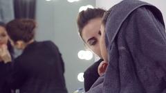 Makeup artist doing models makeup Stock Footage