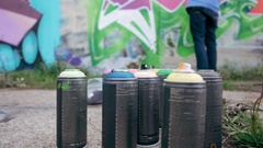 Graffiti artist's cans on the ground, dolly shot Stock Footage