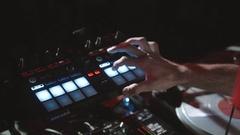 DJ hands on equipment making scratch in nightclub. Disk Jockey on open air Stock Footage
