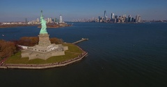 Statue of Liberty Ellis Island NYC Skyline hover slow rise Stock Footage