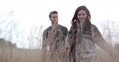 Couple walking in cornfield in fall Stock Footage