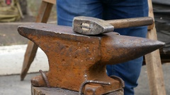 Blacksmith Working on Metal on Anvil Stock Footage