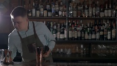 Bartender putting broken ice in shaker with glass Stock Footage