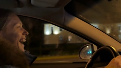 One white blond attractive young woman drives a car at night Stock Footage