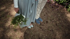 Close-up of feet of a young beautiful couple newlyweds standing in park Stock Footage