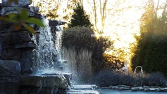 A Wide-Shot of a Waterfall at Sunset Stock Footage