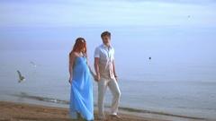 Pregnant couple on sea beach. Couple beach. Love couple walking on beach Stock Footage