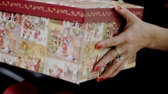 Woman opening Christmas box with present Stock Footage