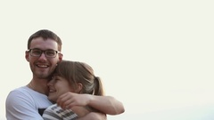 Young beautiful couple of lovers tenderly embrace, smiling and laughing at Stock Footage