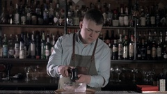 Bartender chopping big ideal ice cubes by khife. Barmen ice figure Stock Footage